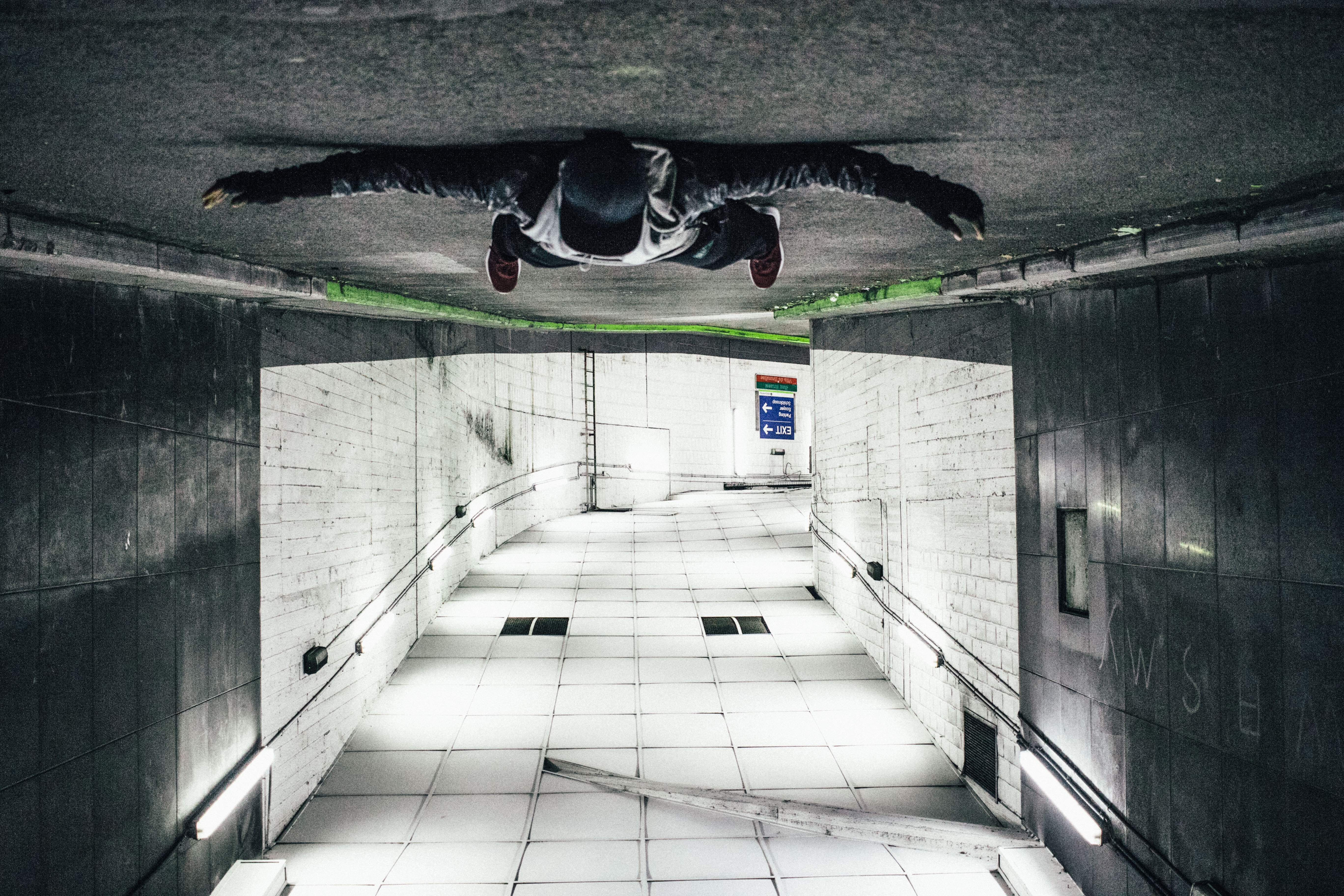 man laying on road tunnel