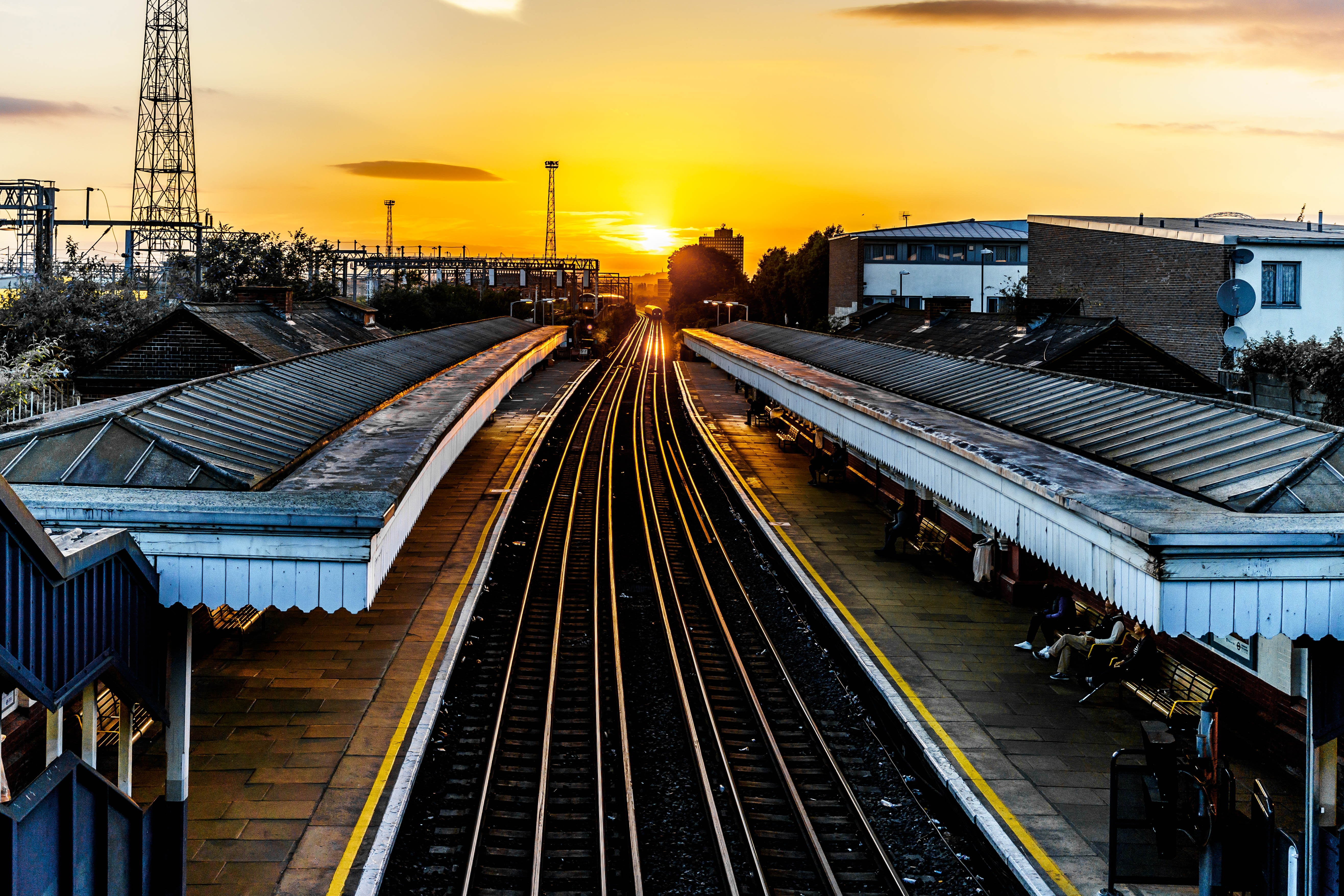 photo of brown train track at sunset