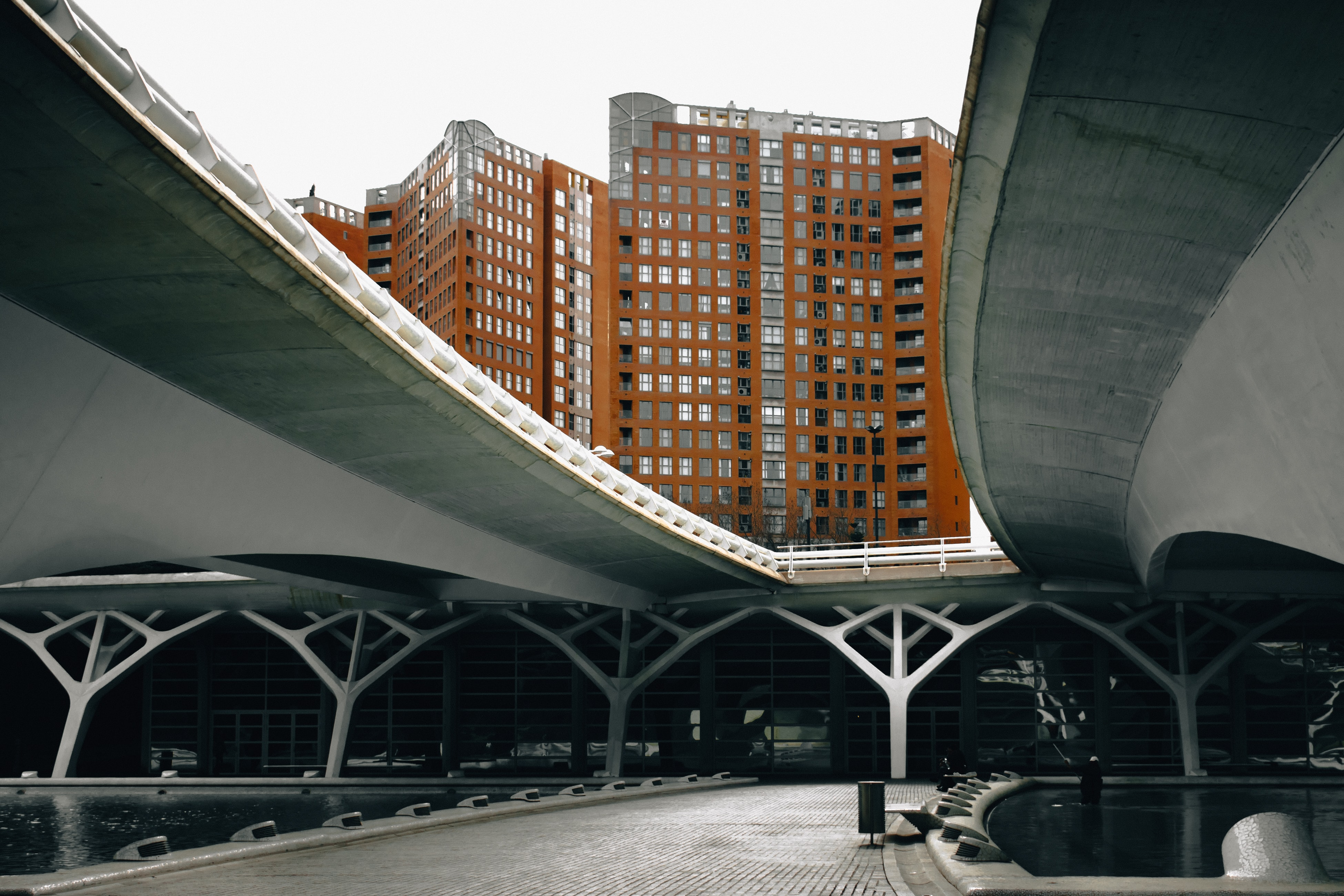 high-angle photography of brown concrete building under white sky