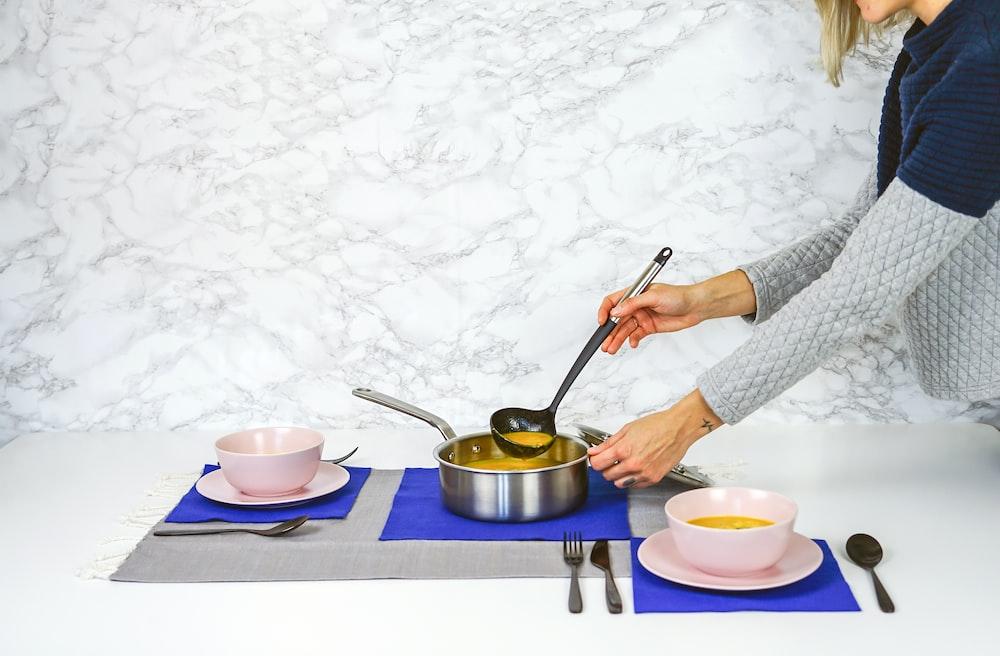 woman serving soup