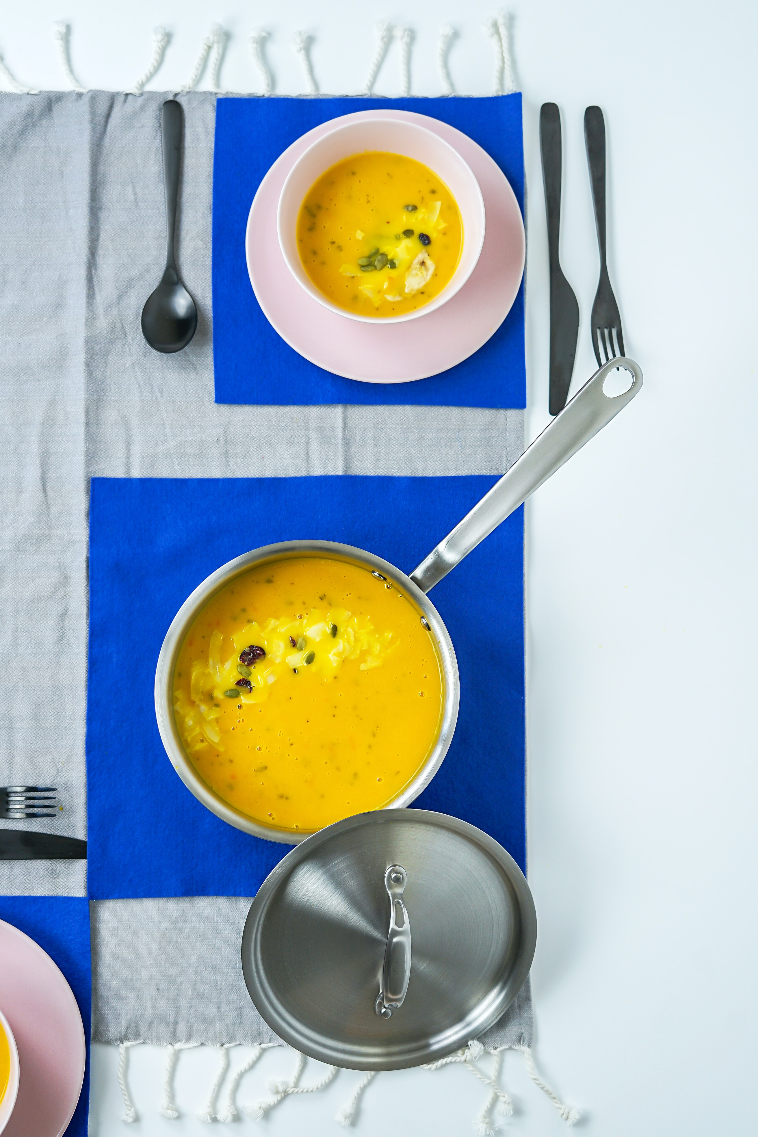 silver sauce pan with squash puree