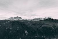 black covered mountain under white sky