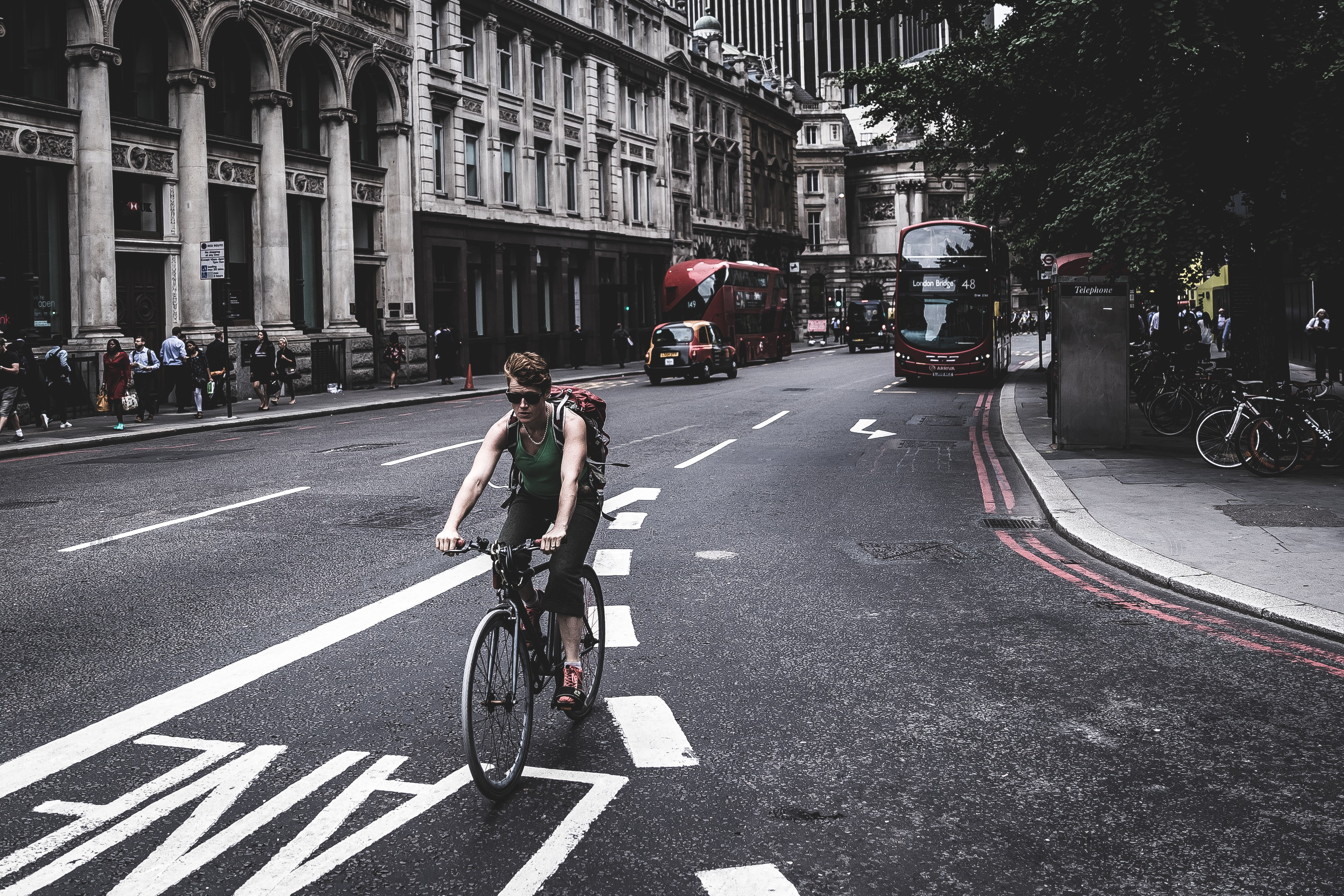 man bicycling at the road