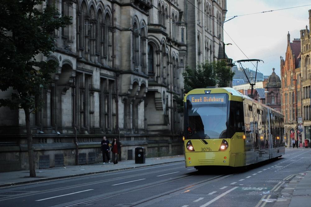yellow and white tram