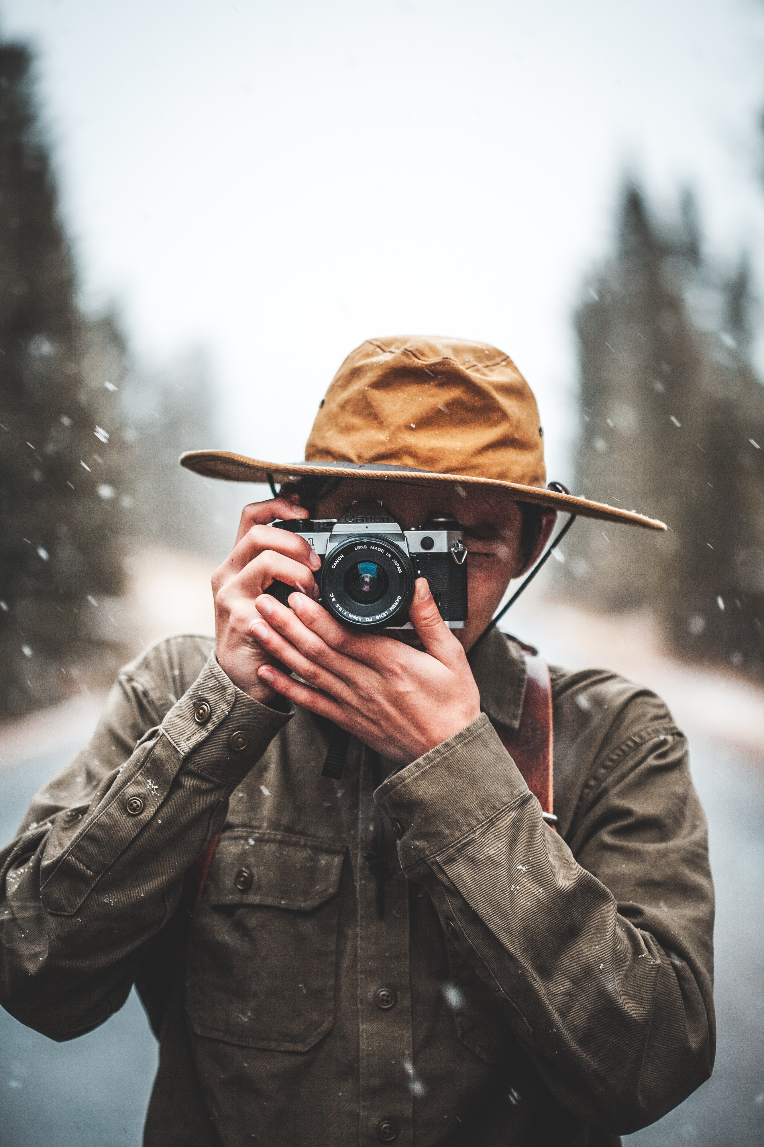 selective focus photography of man taking photo