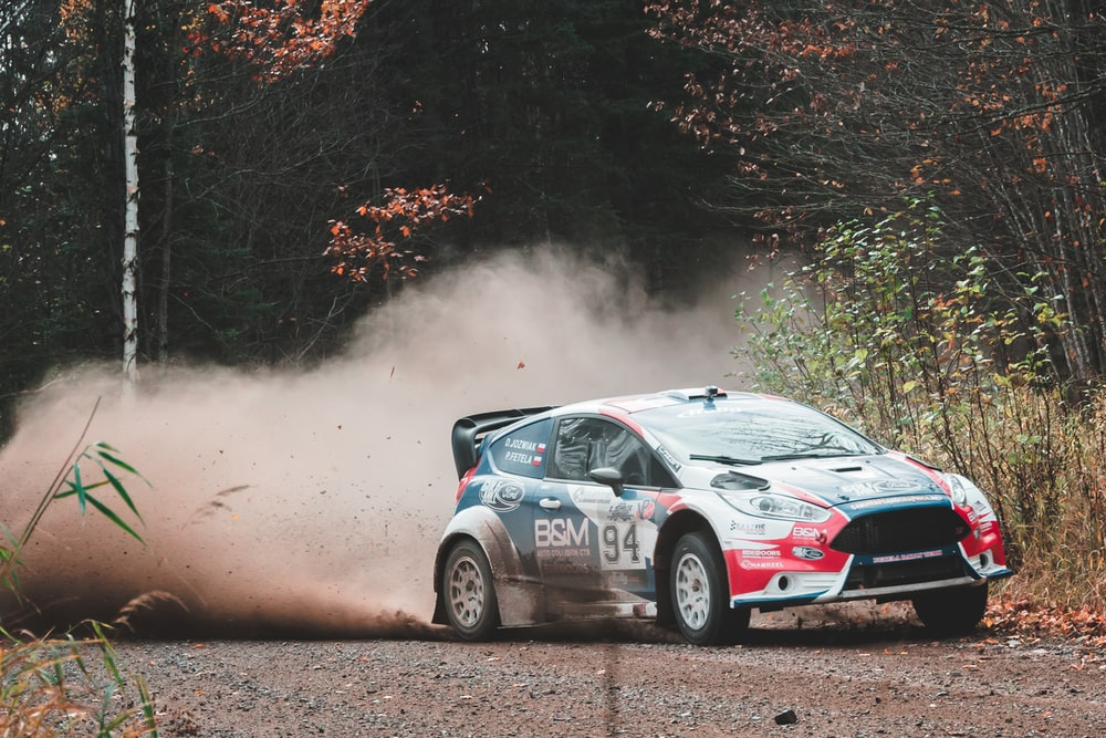 red hatchback on rally trail