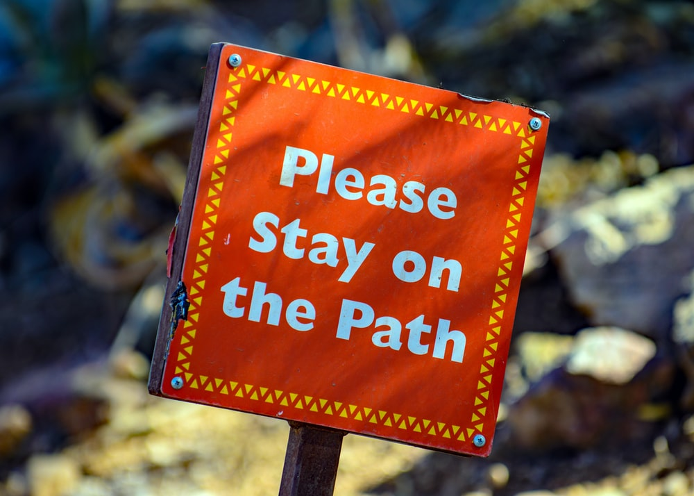please stay on the path signage
