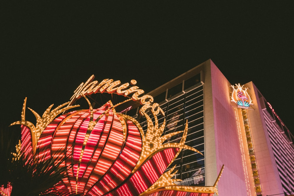 Flamingo building with turned on lights at night in high-angle photography