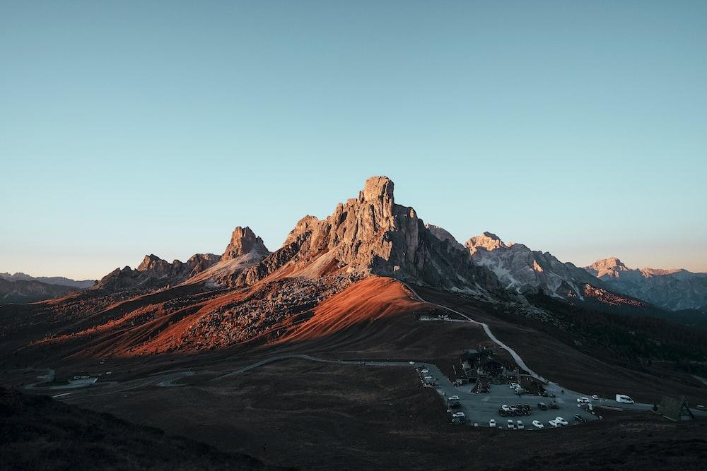 brown rock formation under blue sky