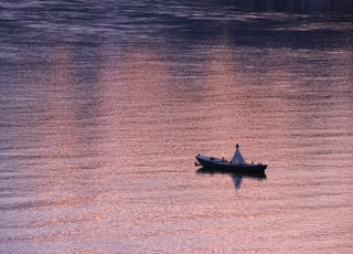 gray boat on boy of water