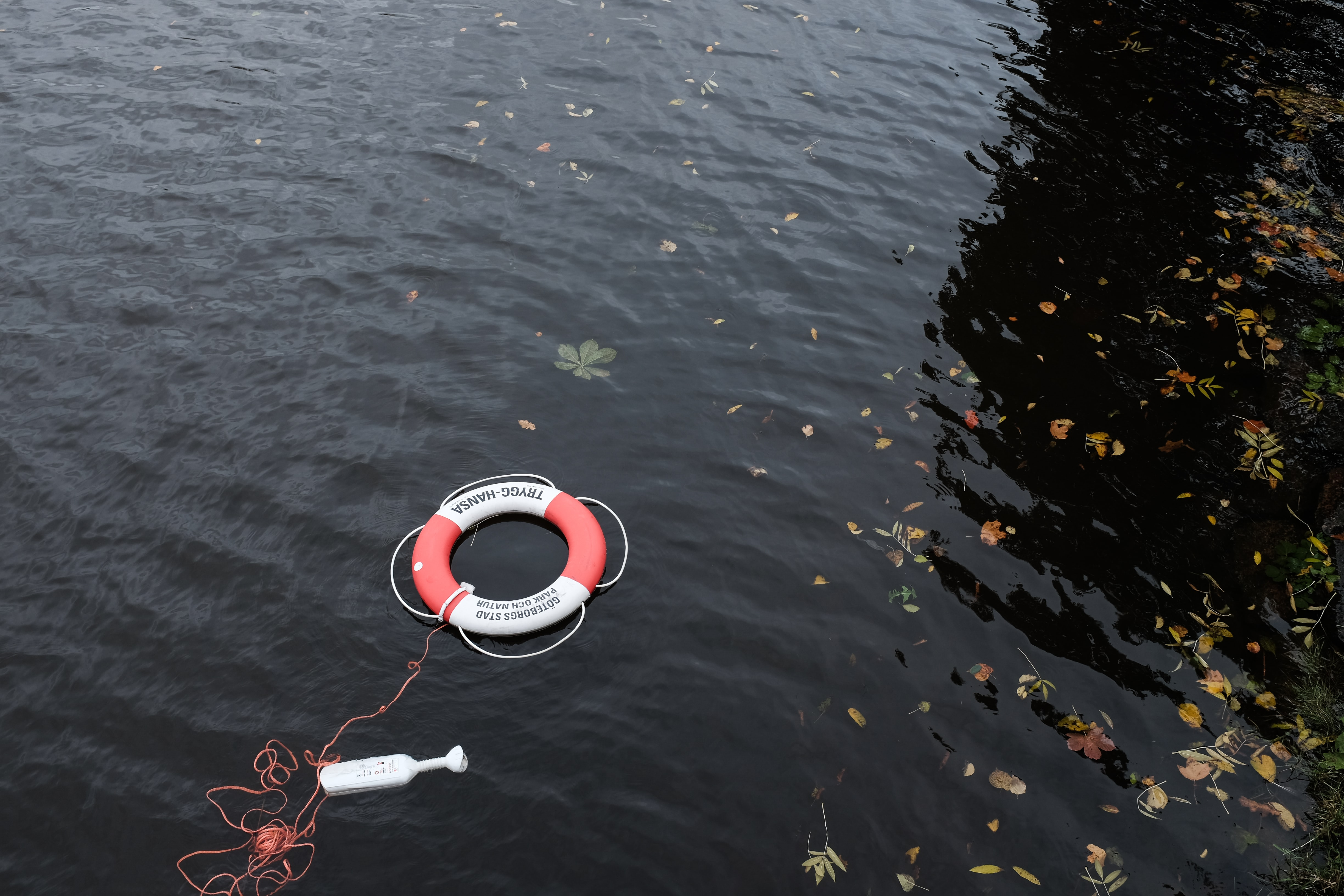 red and white bouy inflatable on water