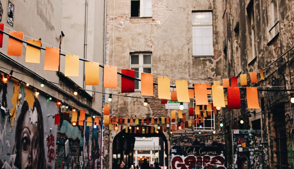 photo of buntings hanged near graffiti artworks