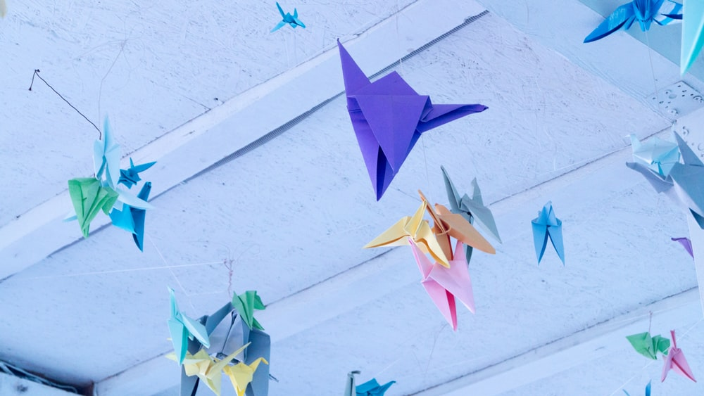 assorted-color origami papers hanged on ceilings