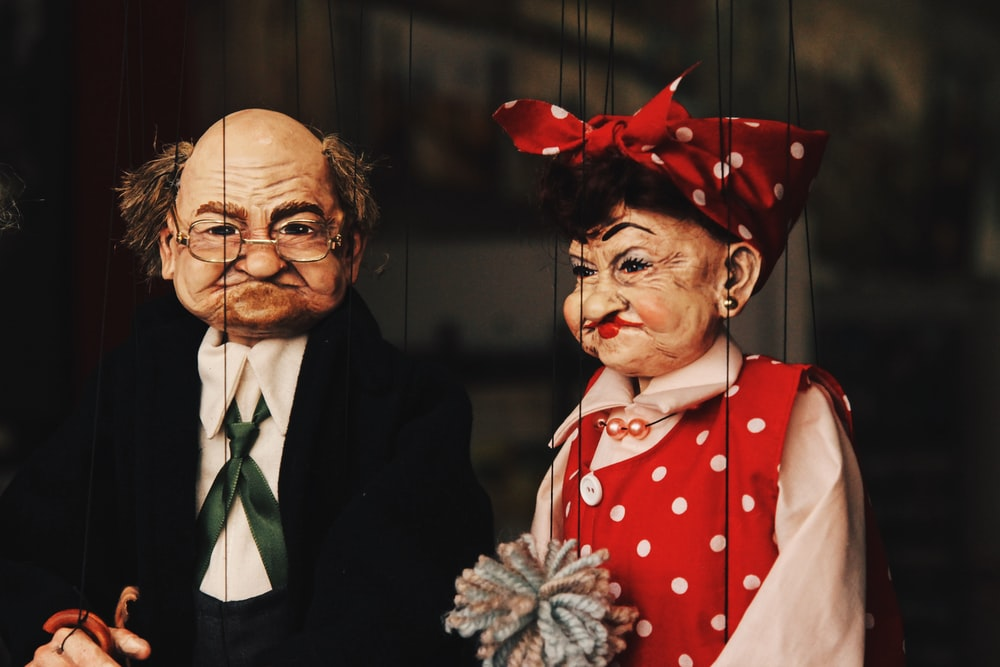 closeup photo of two man and woman puppets