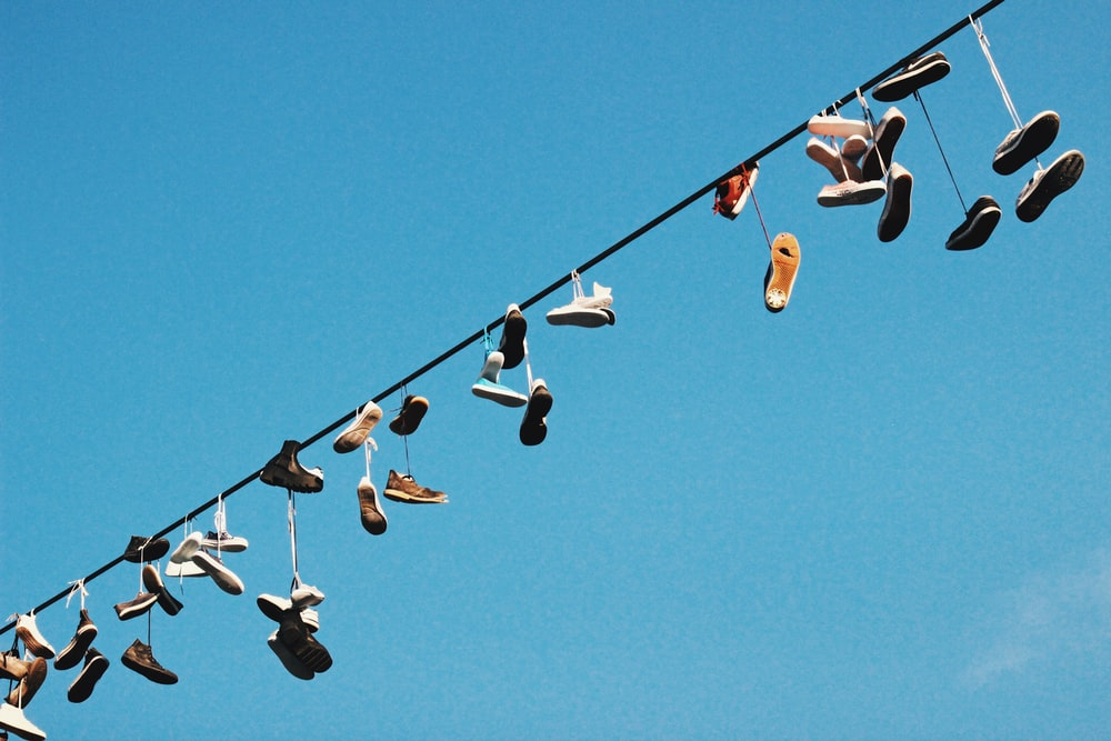 low angle photo of footwear lot