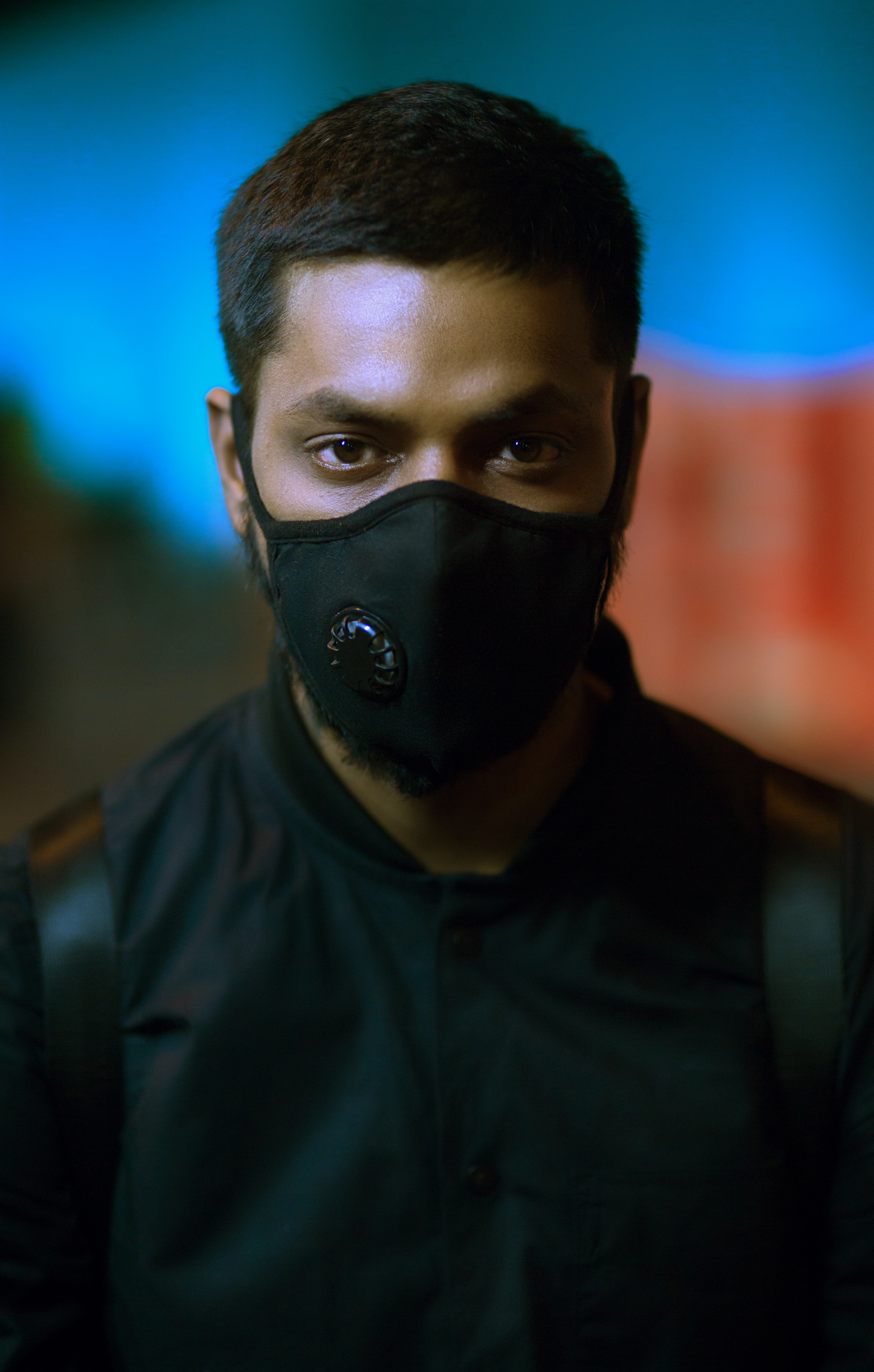 man wearing black mask