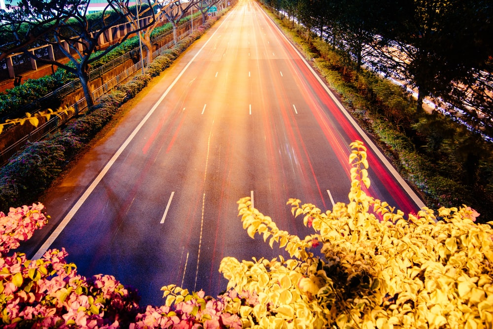 time-lapsed photography of the road with red car lights
