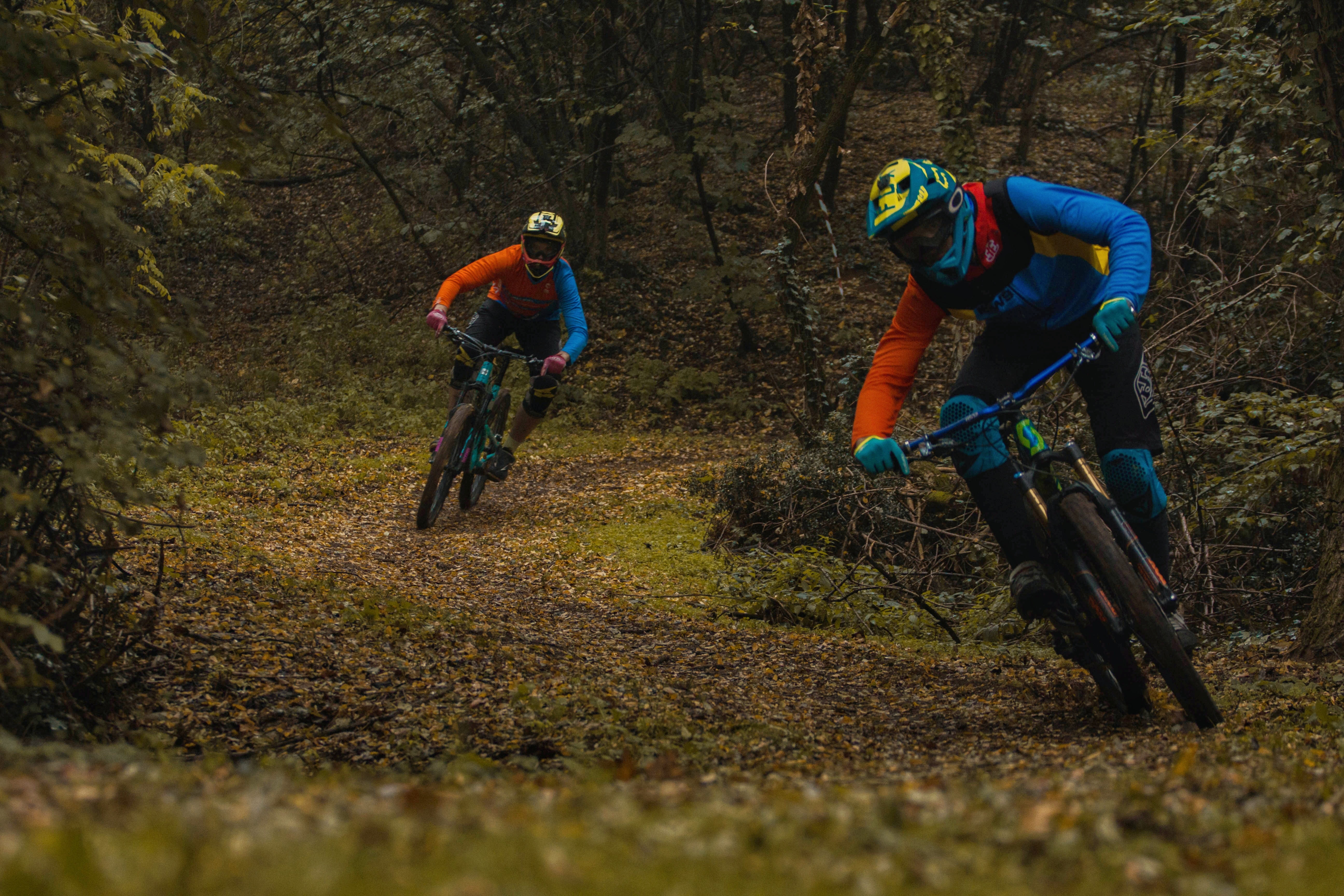 two person riding hardtail bikes on trail