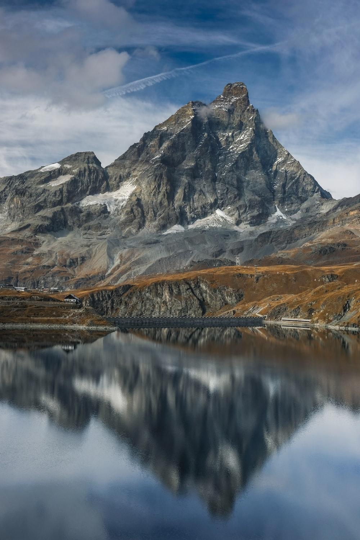 gray rocky mountain under blue sky