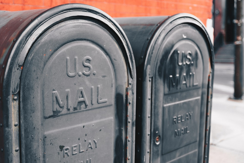 close view of two gray U.S mailboxes usps