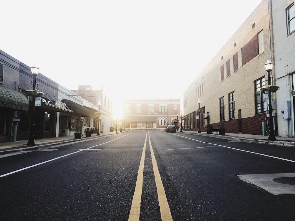 road between buildings taken during daytime