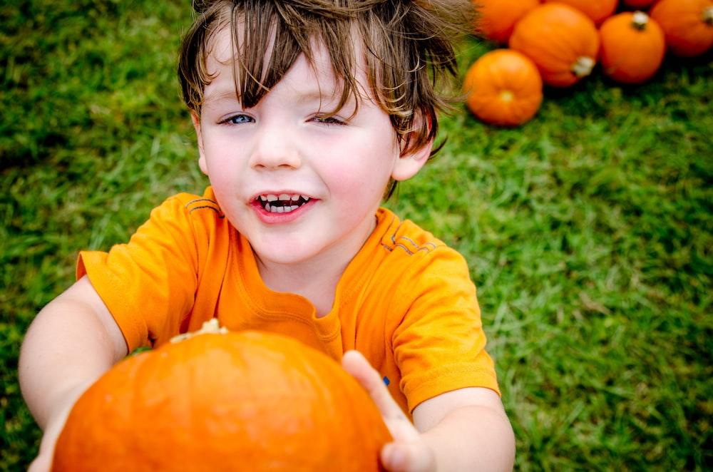boy holding squash