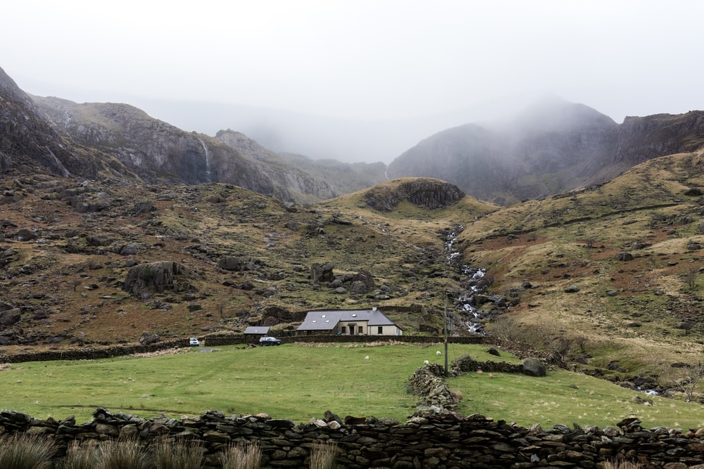 gray house surrounded with mountain