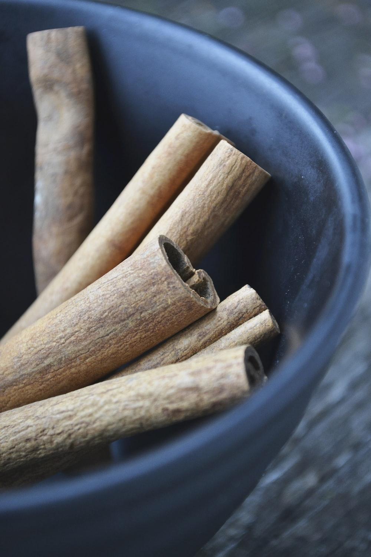 cinnamon in round blue bowl