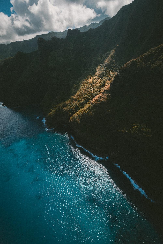 bird's eye view of mountain and ocean