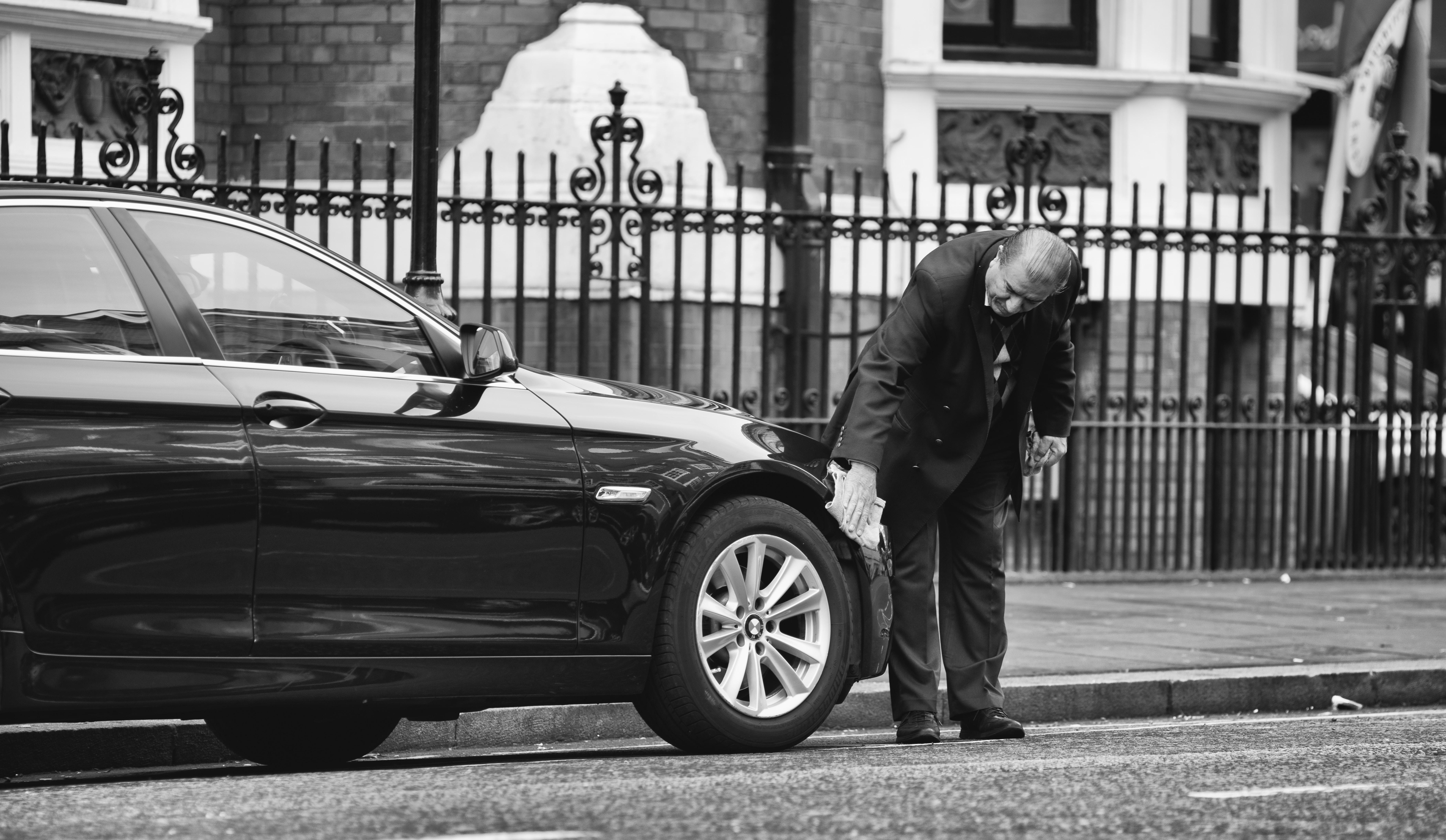 man holding vehicle tire