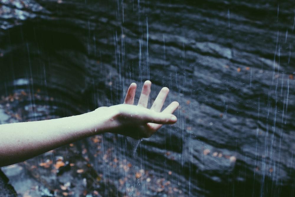 person catching rain drops