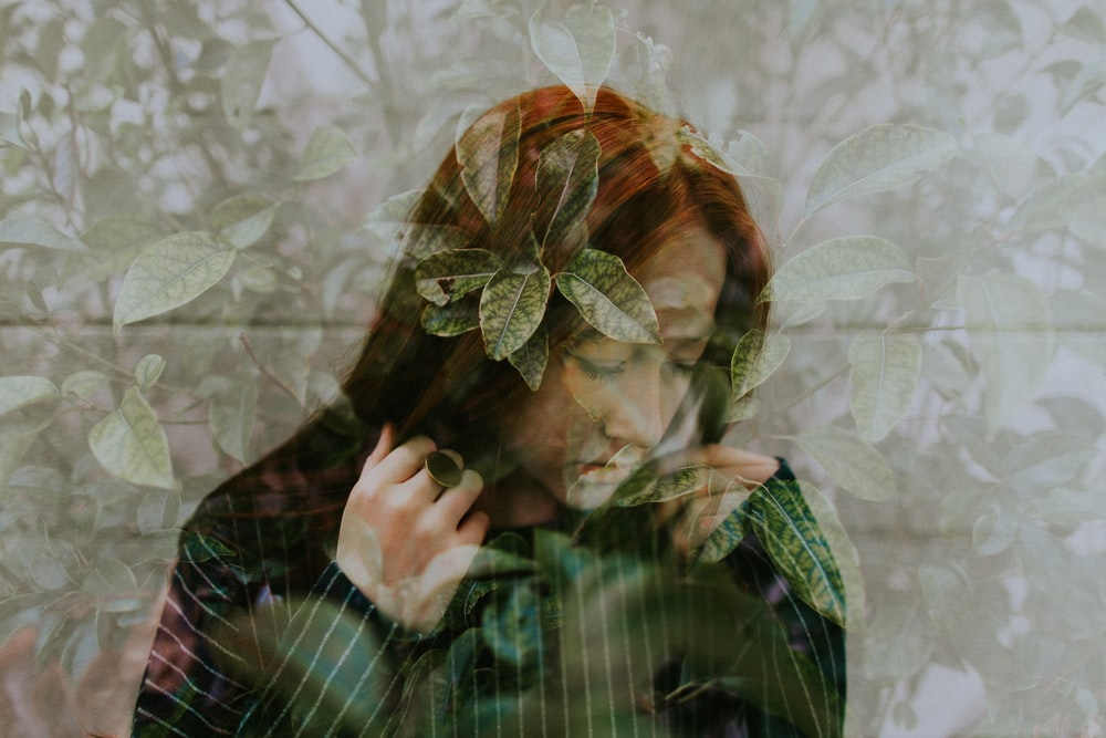 woman in long-sleeved top with floral photo effects