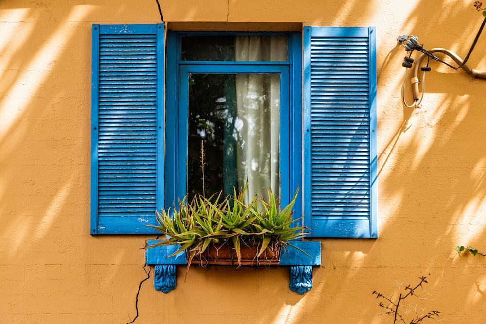 photo of blue open window