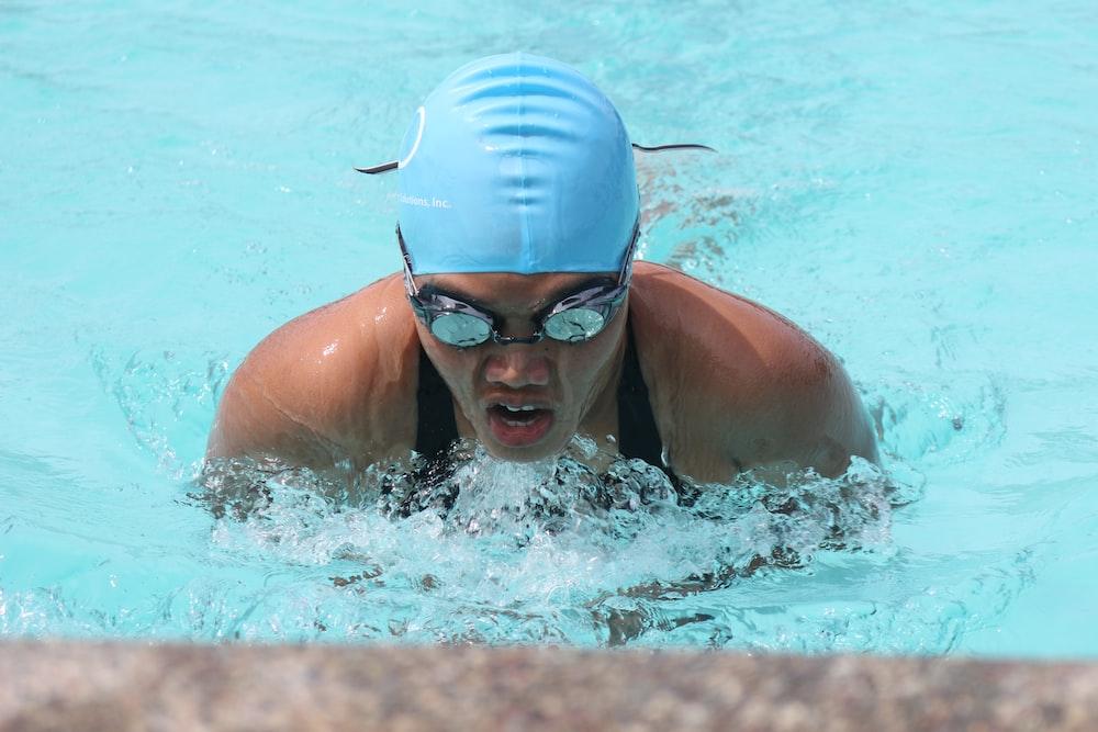 person swim on inground pool