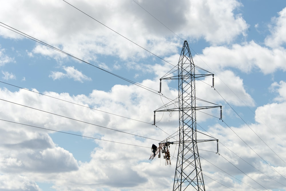 wires passing along transmission tower