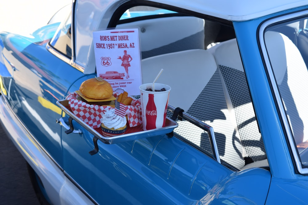 hamburger, soda, and ice cream set next to pick-up