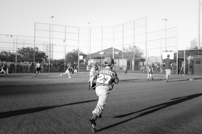 grayscale photo of children playing baseball