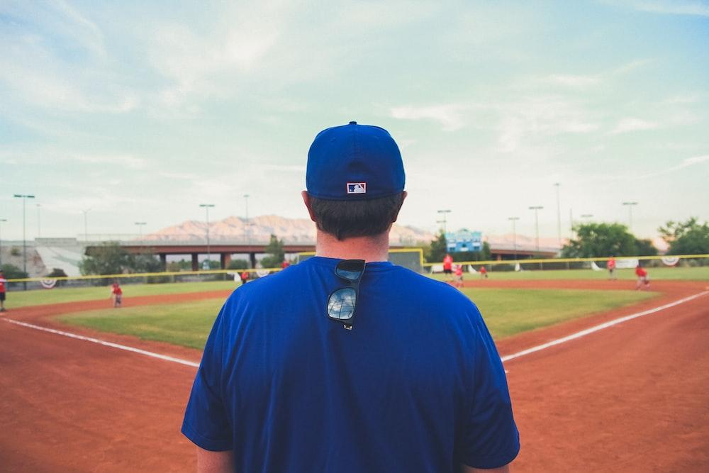 man overlooking baseball field