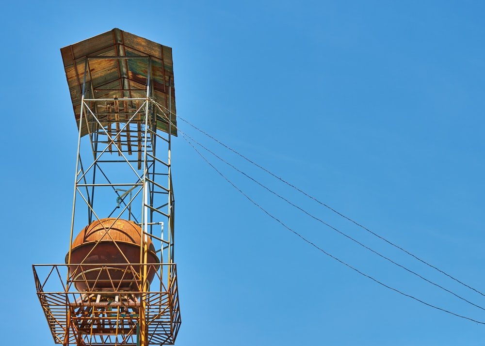 photo of tower with cables