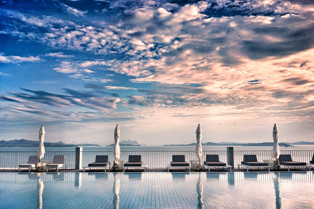 loungers near pool under gray clouds