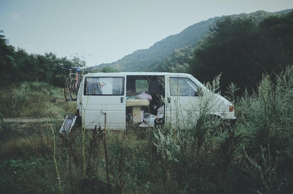 van parked in grass field