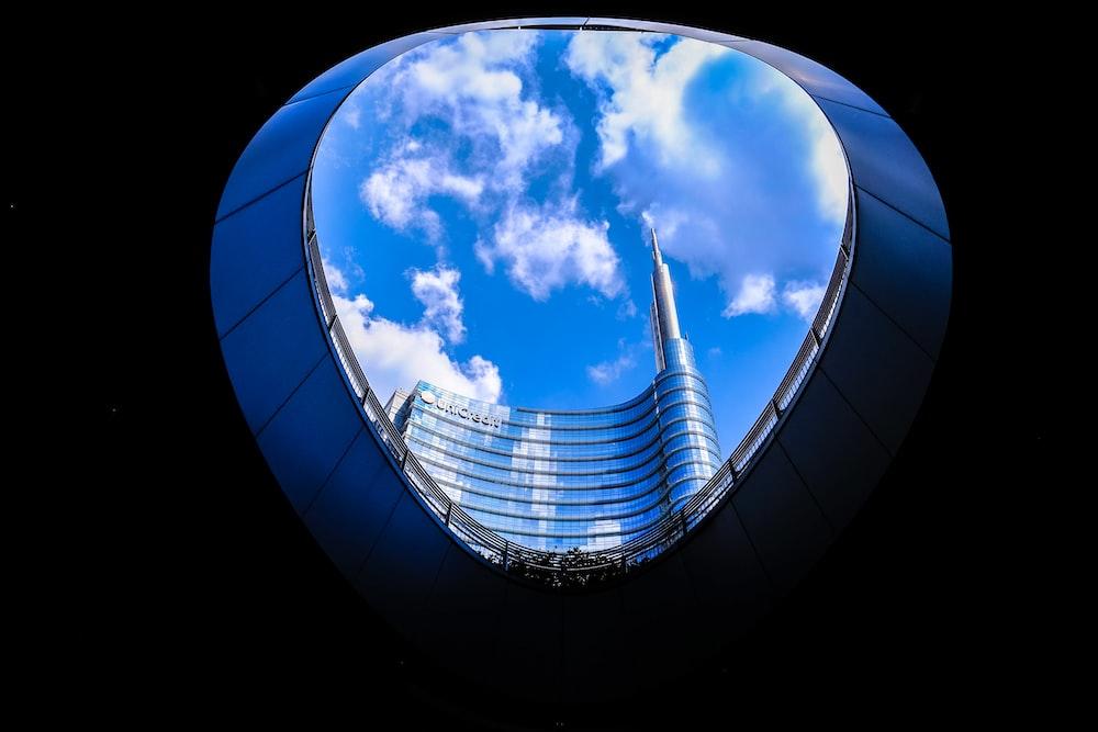 worm's eye view gray steel building