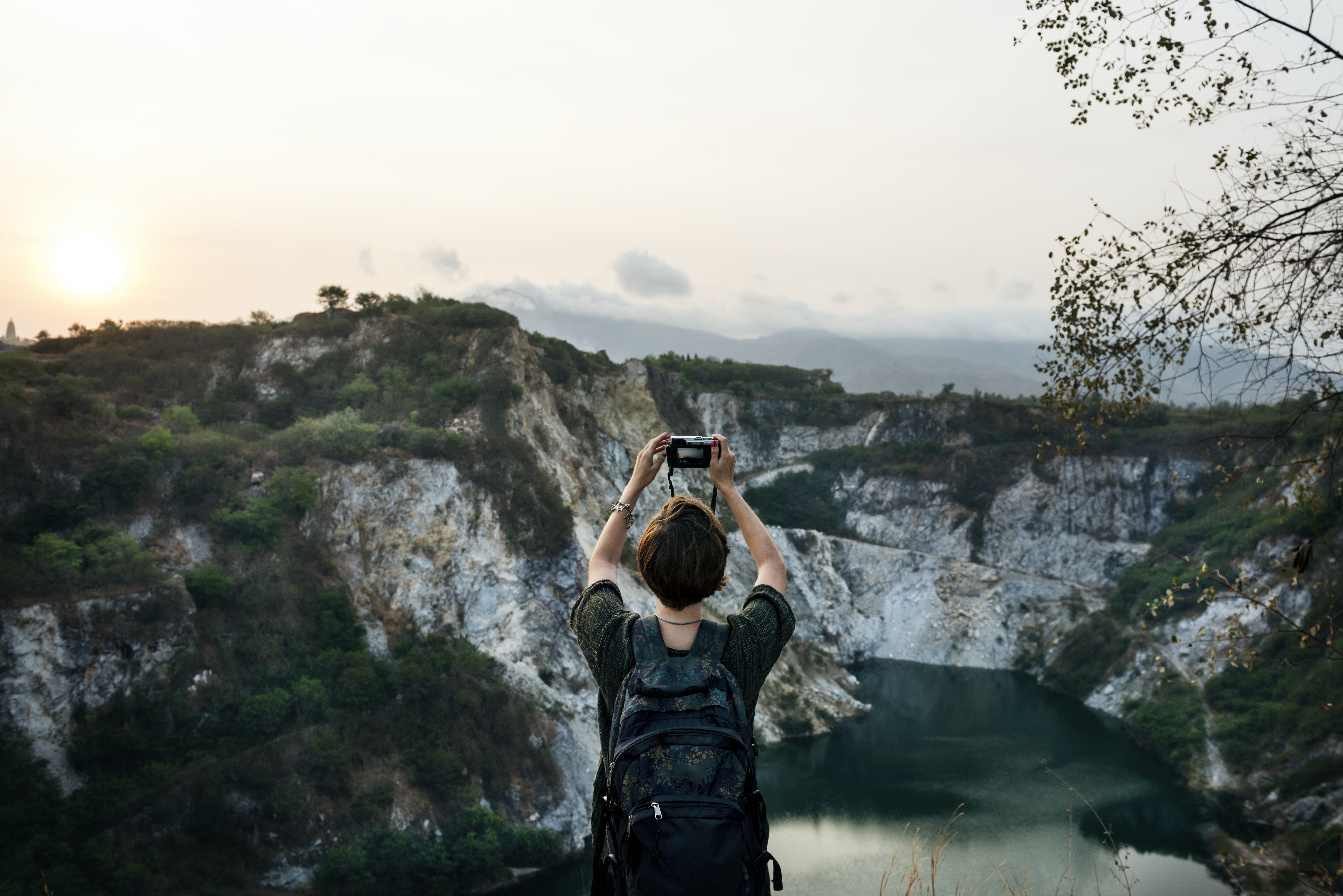 woman taking picture of a mountain