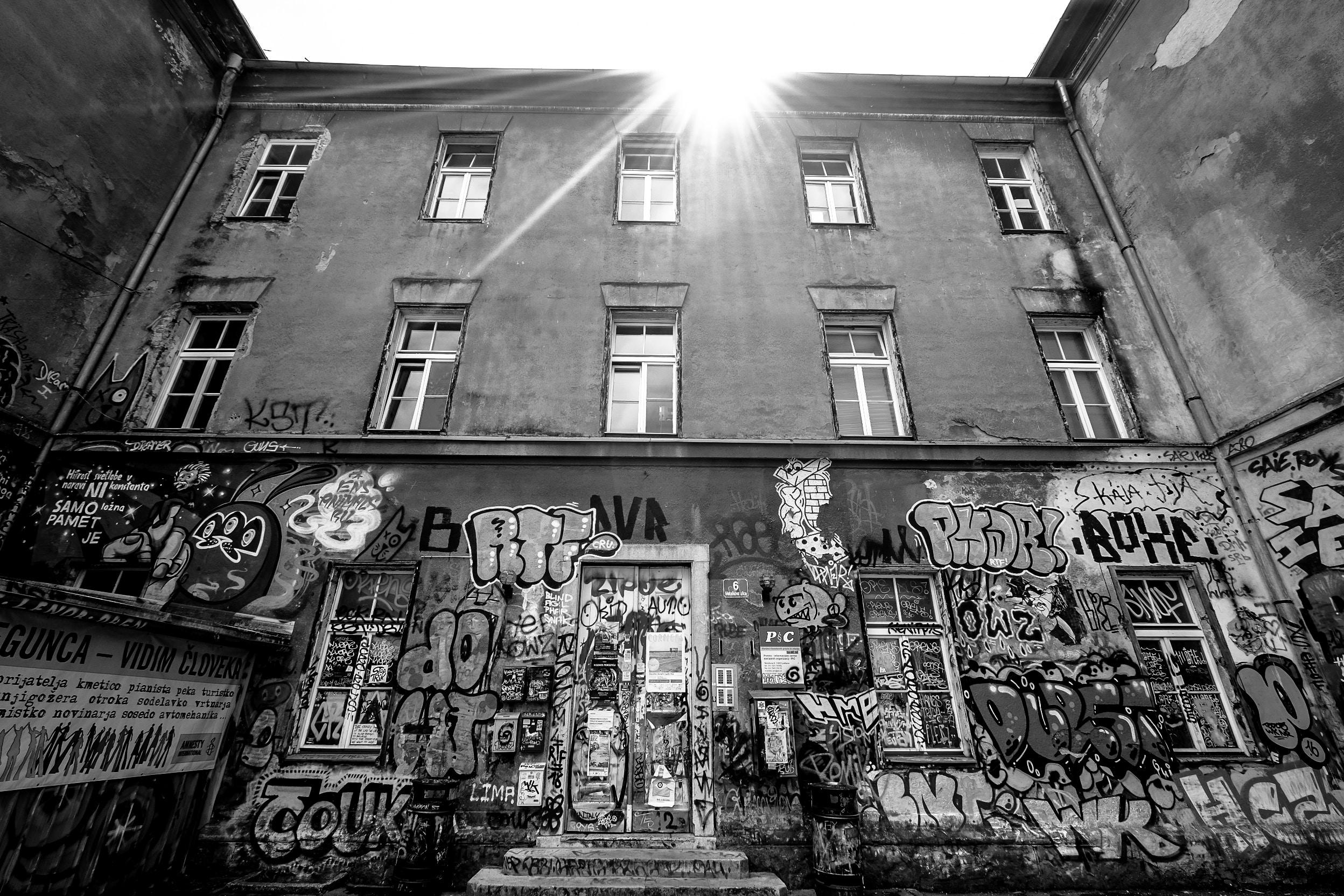grayscale photo of graffiti
