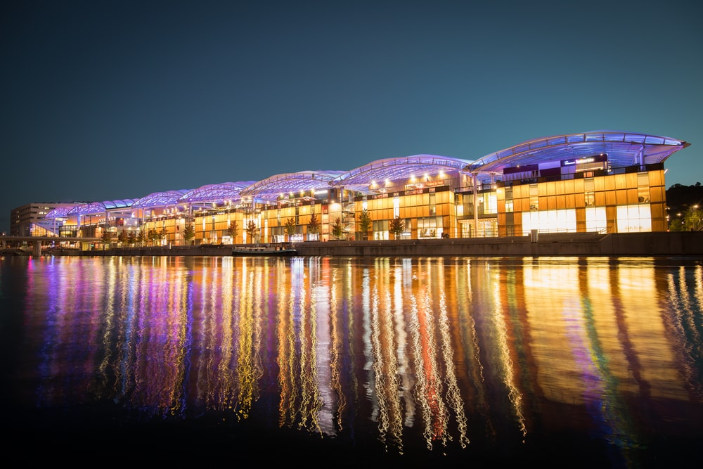 panoramic photography of lighted houses near body of water