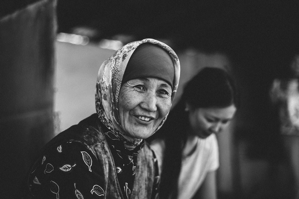 grayscale photo of a woman wearing hijab