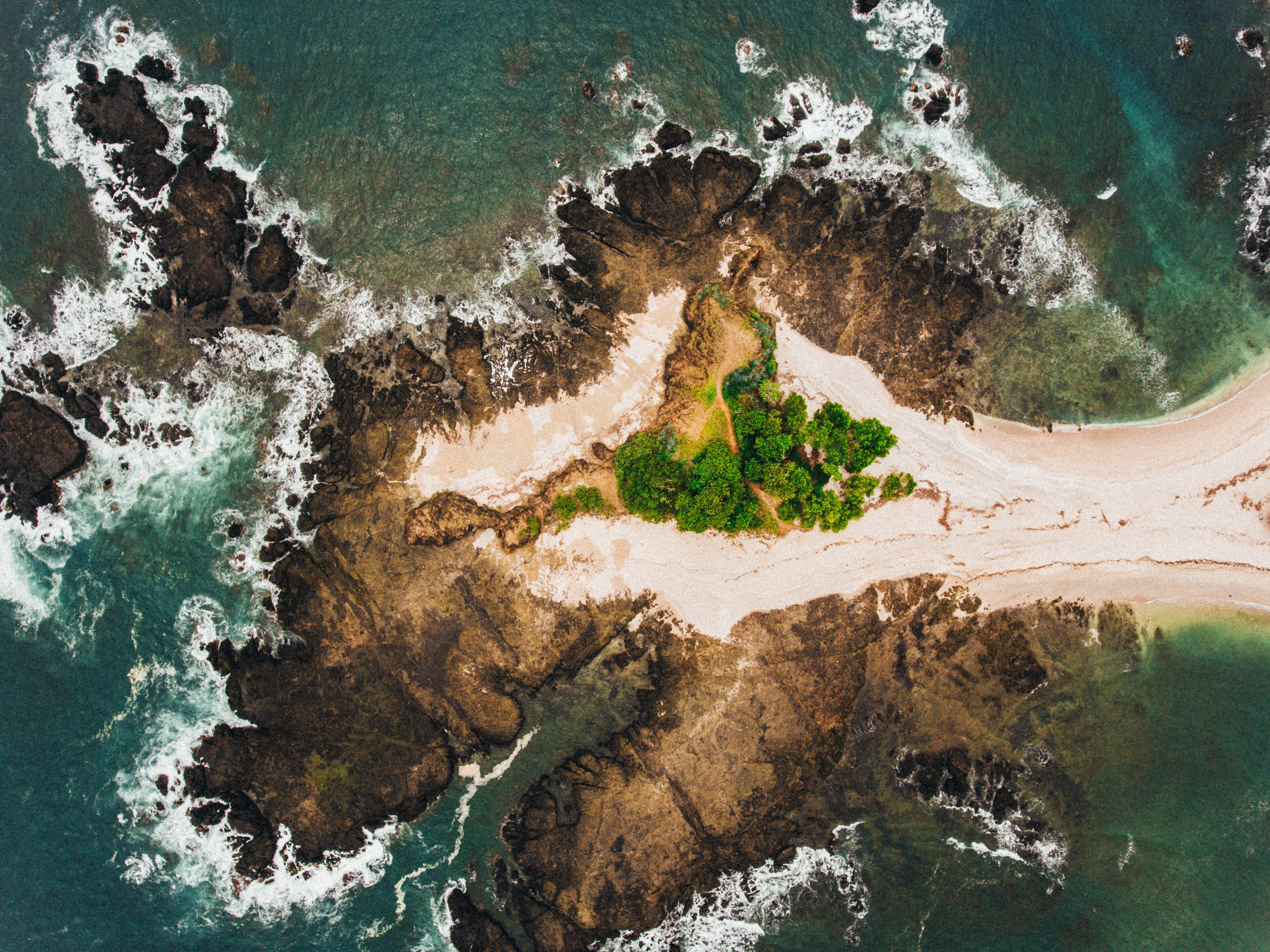 island surrounded by ocean water