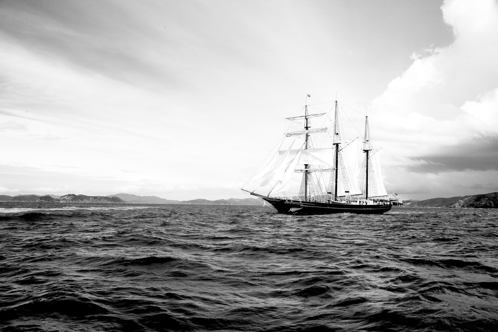 grayscale photography of galleon ship on waters