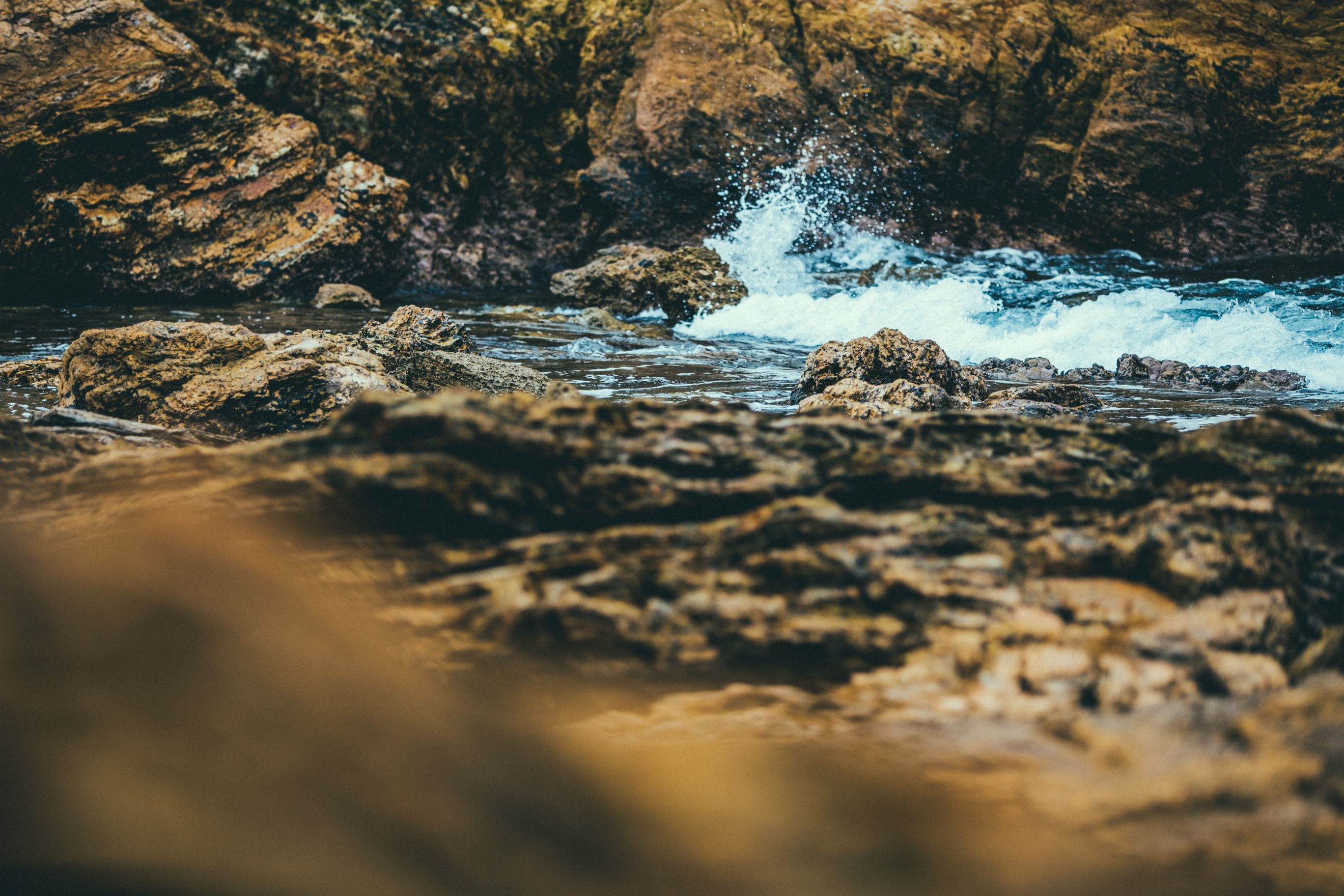 landscape photography of rock structure near body of water