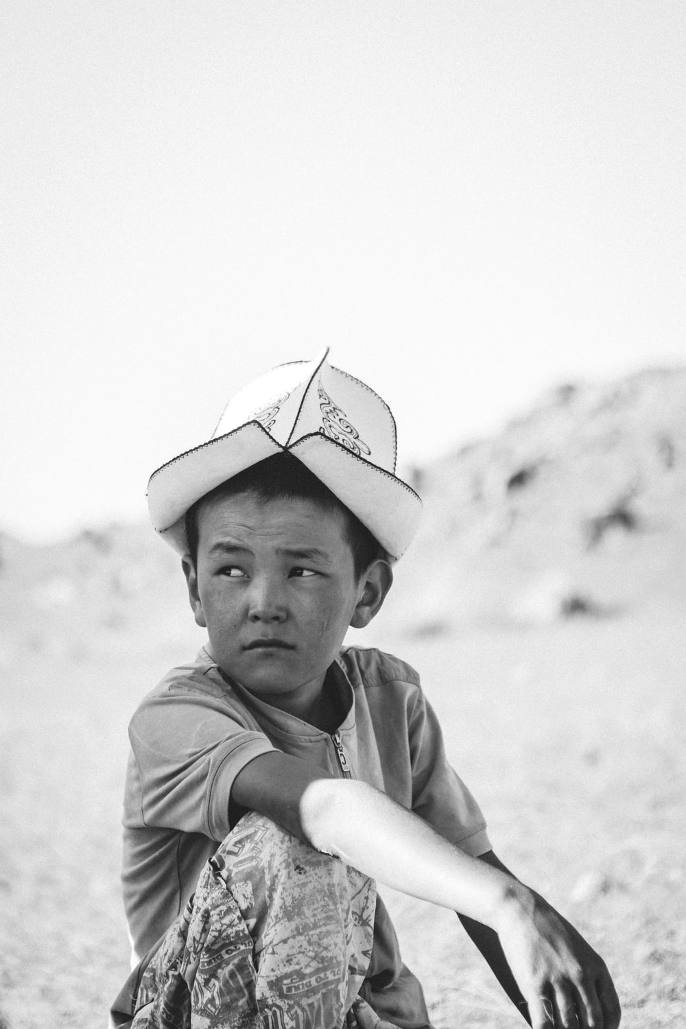 grayscale photography of box with hat